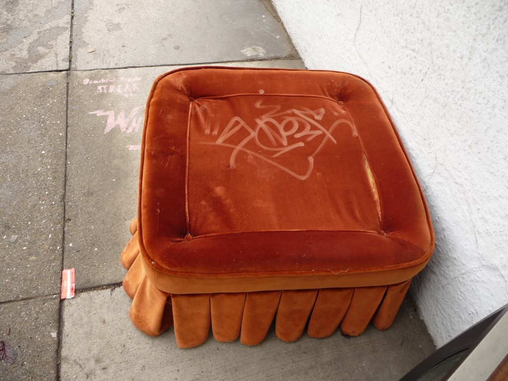 tagged velvet ottomon sat on the sidewalk for days