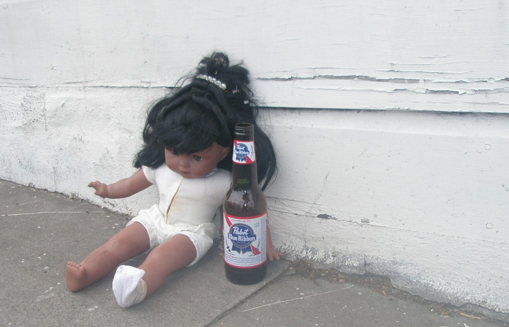 doll holding beer